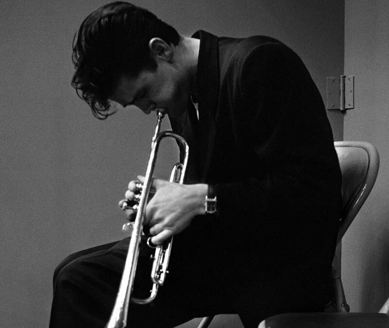Chet Baker plays trumpet.